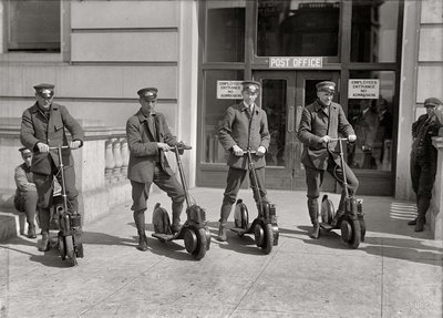 Postmen on scooters